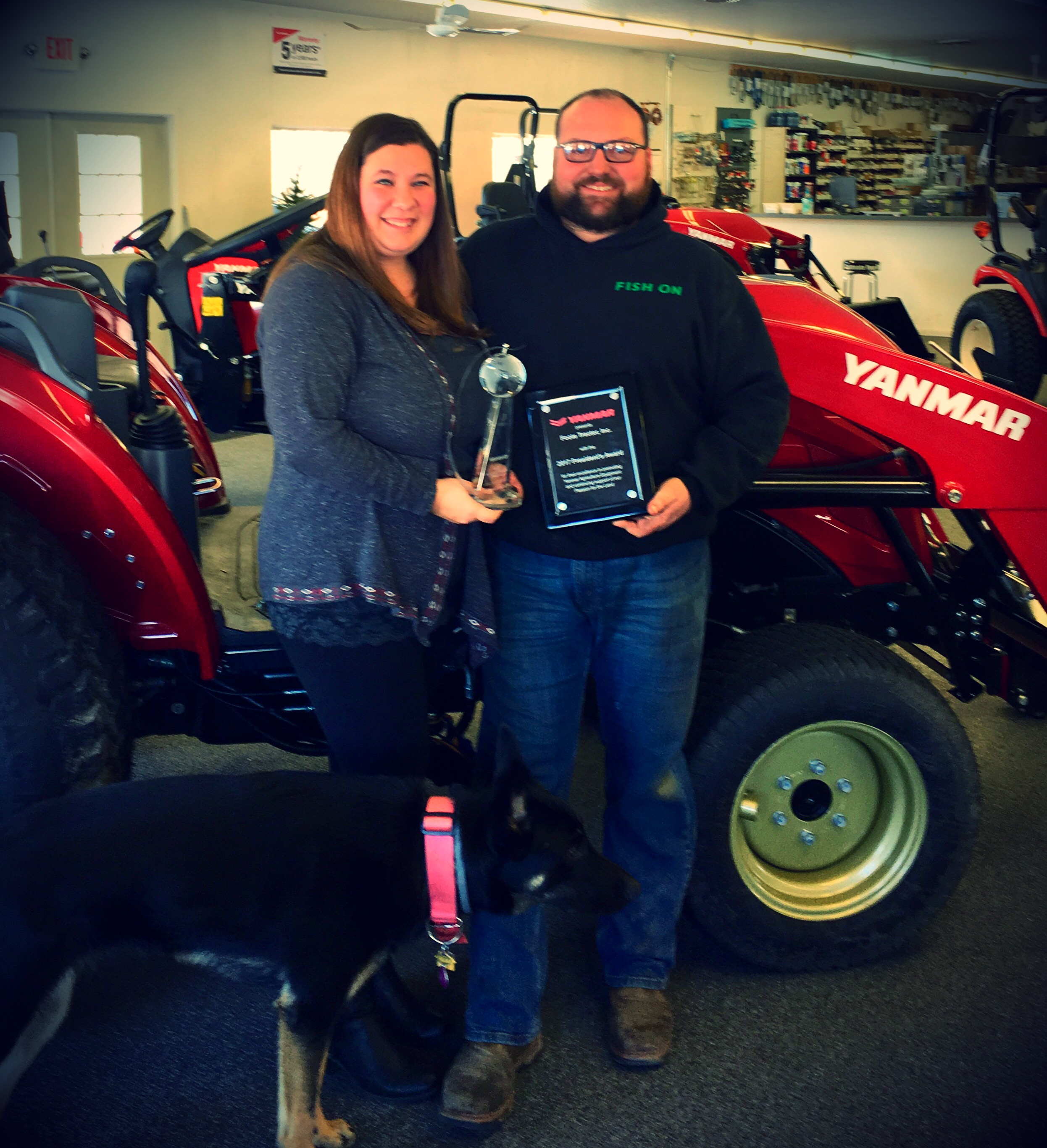 Tom and Tiffany with the Yanmar Dealer of the Year and President's Awards